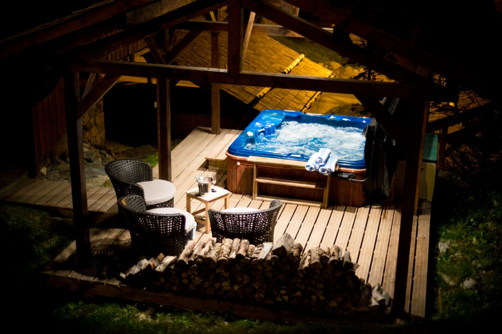 Outdoor hot tubs in all catered chalets